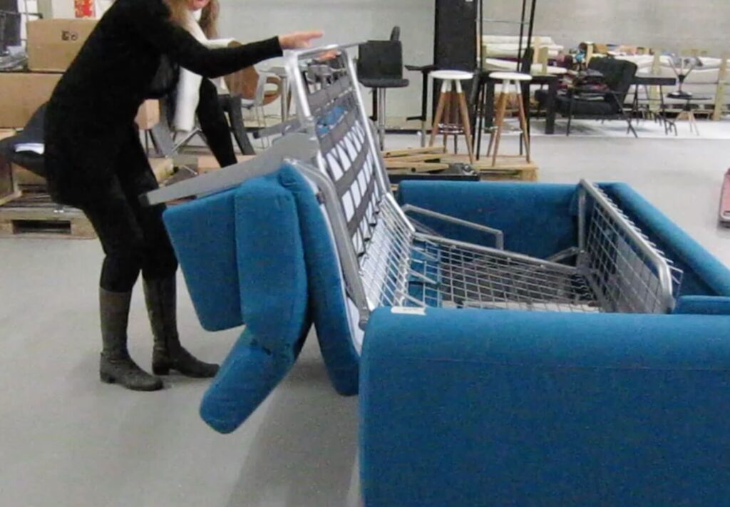 women folding a sofa-cum bed
